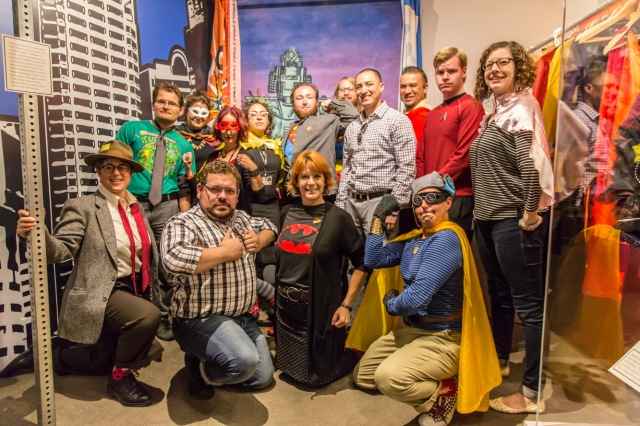 "SDSU students and OMCA staff pose in the ""Sunshine and Superheroes"" exhibit."